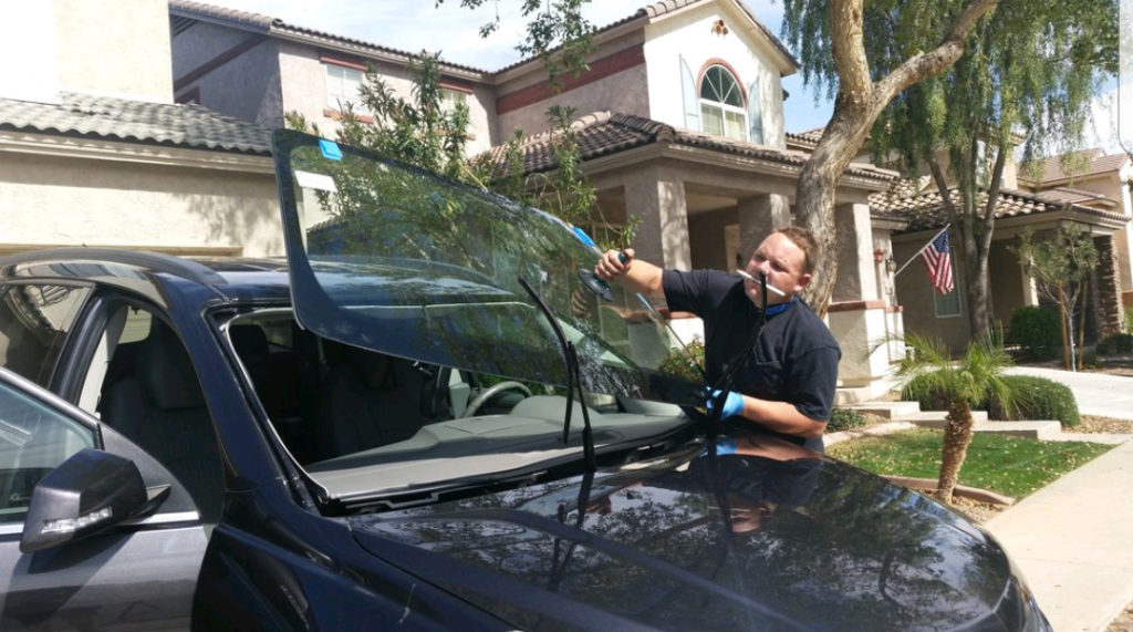Auto Glass Technician Installing New Windshield