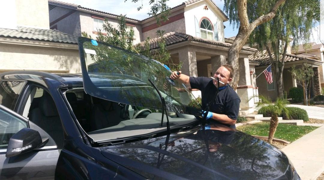 Auto Glass Technician Installing New Windshield