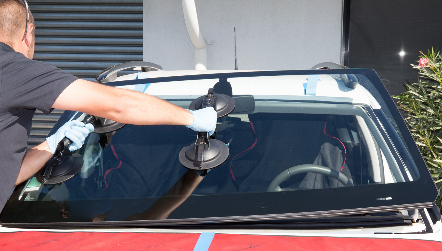 Windshield Replacement Man Installing on Car in Chandler AZ