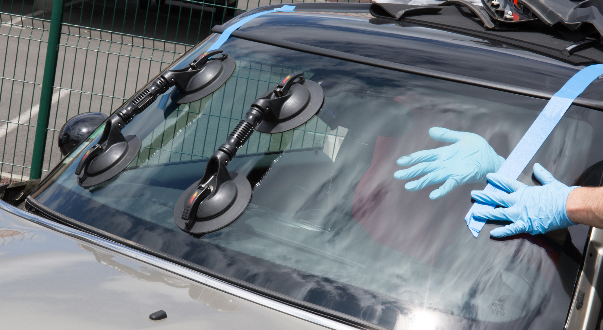 Technician Replacing Auto Windshield Lakewood Colorado